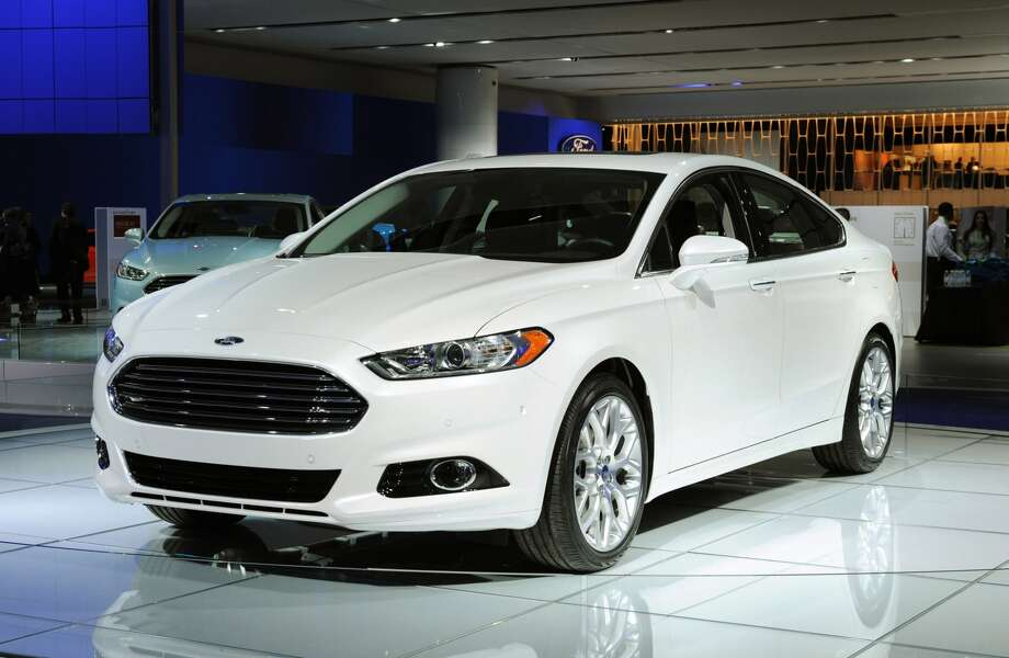 2013 Ford Fusion:  Experts say the car, which is expected to be priced between $22,000 to $30,000, could redefine the mid-sized car business. The car takes design cues from Aston Martin with options for gasoline, hybrid and plug-in and hybrid powertrains.