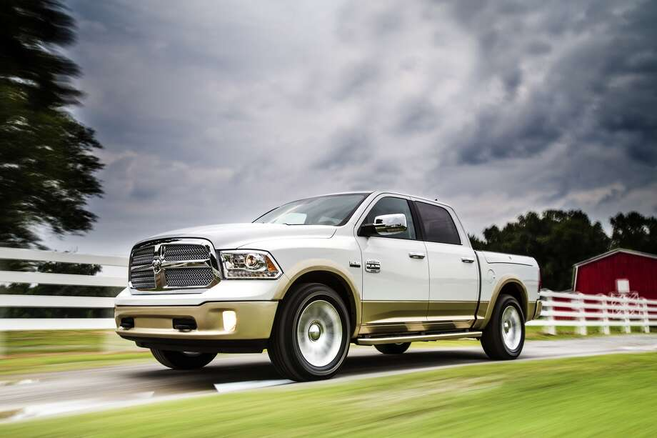 2013 Dodge Ram 1500: Trucks aren't known for their gas mileage, but Dodge is hoping to change that. The car company redid the truck's suspension system and engine to give it better fuel economy.
