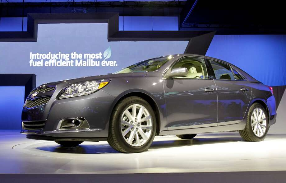 """2013 Chevrolet Malibu: Chevrolet ditched the 6-cylinder engine to boost the fuel ecoomy. Consumers will also have the option of a """"light"""" hybrid powertrain that'll improve the gas mileage."""