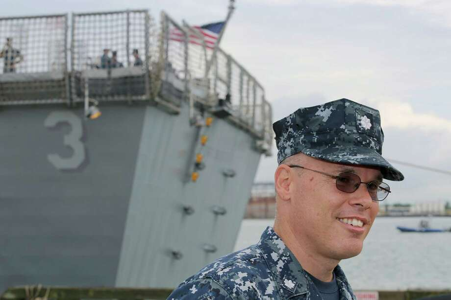 Navy Commander Randy Blankenship answers questions about the USS Fort Worth as it docks in Galveston. The ship is named for Fort Worth, Texas, the 17th largest city in the United States and the 5th largest city in Texas. It is the first ship to bear the name and is the second ship in the Freedom-variant of littoral combat ships. Photo: Thomas B. Shea, For The Chronicle / © 2012 Thomas B. Shea
