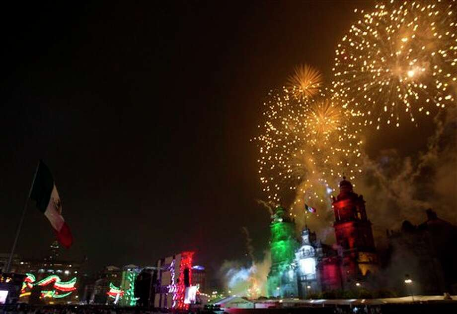 "Fireworks explode over the Metropolitan Cathedral for Independence Day celebrations at the Zocalo in Mexico City, late Thursday, Sept. 15, 2011. Mexico is marking the 202nd anniversary of the ""Grito de Dolores,"" honoring the call to arms made by the priest Miguel Hidalgo in 1810 that began the struggle for independence from Spain, achieved in 1821. (AP Photo/Eduardo Verdugo) Photo: Associated Press"