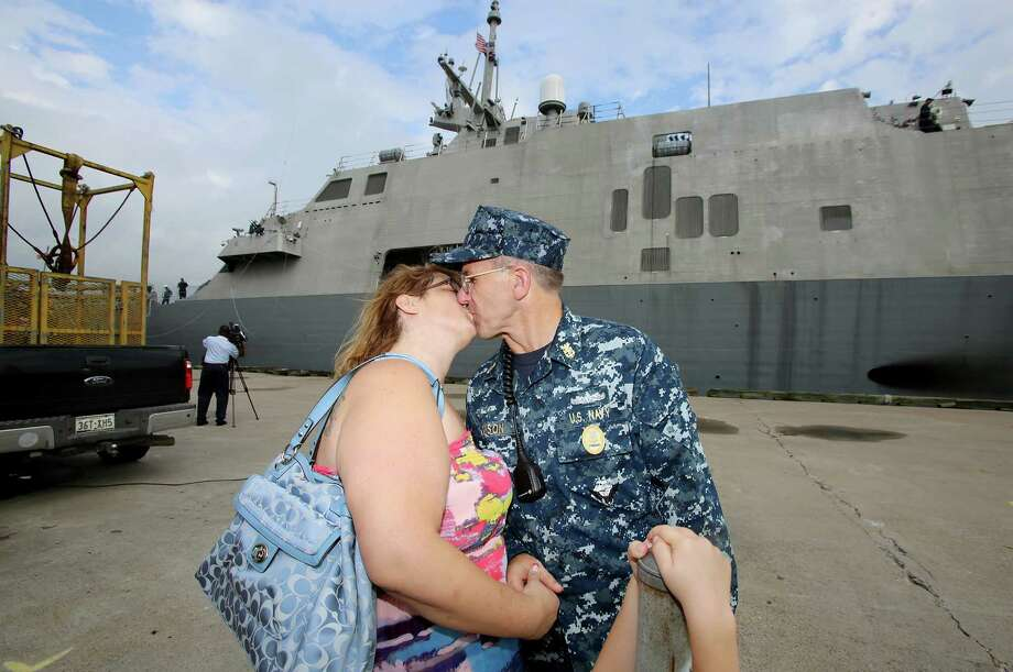 Command Master Chief Richard Henson gives his wife, Melanie Henson, a kiss before returning to duty on the USS Fort Worth, which docked Monday in Galveston. Melanie flew in with sons Justin and Dalton Henson and daughter Mary Henson from San Diego, Calif. to see her husband. Photo: Thomas B. Shea, For The Chronicle / © 2012 Thomas B. Shea