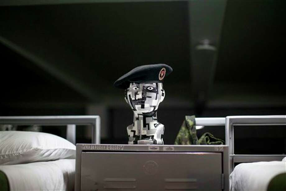 A Mexican army special forces beret sits on a mannequin's head  at a dormitory in a military base in Mexico City, prior to the military parade of the Independence Day celebrations, Sunday Sept. 16, 2012. Mexico celebrates the 202nd anniversary of its 1810 independence uprising. (AP Photo/Alexandre Meneghini) Photo: Associated Press