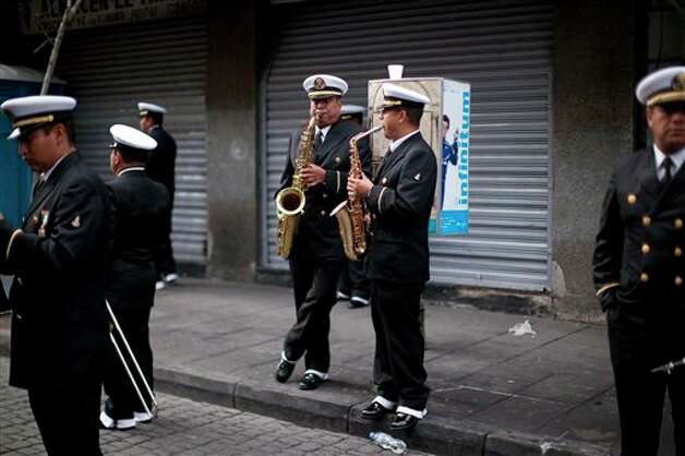 Members of the Mexican navy band practice prior to the military parade of the Independence Day celebrations, Mexico City, Sunday Sept. 16, 2012. Mexico celebrates the 202nd anniversary of its 1810 independence uprising. (AP Photo/Alexandre Meneghini) Photo: Associated Press