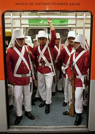 Members of the Mexican army wearing historical uniforms ride in the subway on their way to downtown Mexico City, prior to the military parade of the Independence Day celebrations, Mexico City, Sunday Sept. 16, 2012. Mexico celebrates the 202nd anniversary of its 1810 independence uprising. (AP Photo/Alexandre Meneghini) Photo: Associated Press