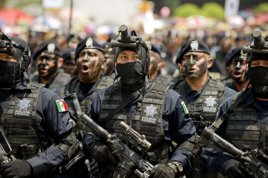 Mexican Federal Police members march during the celebration of the 202nd anniversary of the country's independence at Juarez Avenue in Mexico City on September 16, 2012.   AFP PHOTO/Alfredo Estrella        (Photo credit should read ALFREDO ESTRELLA/AFP/GettyImages) Photo: Getty Images