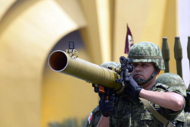 A Mexican Army soldier holds an anti-tank weapon during the celebration of the 202nd anniversary of the country's independence at Juarez Avenue in Mexico City on September 16, 2012.   AFP PHOTO/Alfredo Estrella        (Photo credit should read ALFREDO ESTRELLA/AFP/GettyImages) Photo: Getty Images