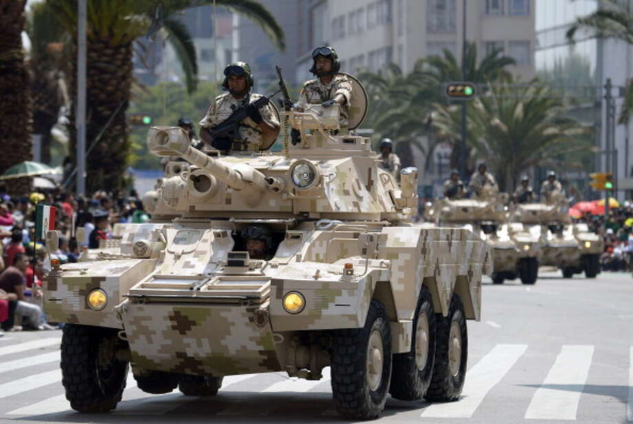 Mexican Army panhard armored cars parade during the celebration of the 202nd anniversary of the country's independence at Juarez Avenue in Mexico City on September 16, 2012.   AFP PHOTO/Alfredo Estrella        (Photo credit should read ALFREDO ESTRELLA/AFP/GettyImages) Photo: Getty Images