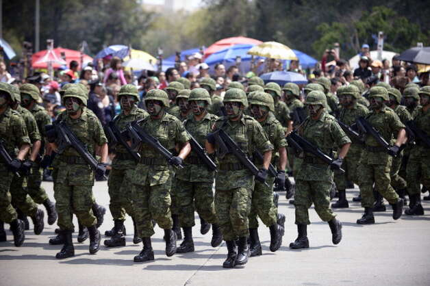 Mexican Army soldiers march during the celebration of the 202nd anniversary of the country's independence at Juarez Avenue in Mexico City on September 16, 2012.   AFP PHOTO/Alfredo Estrella        (Photo credit should read ALFREDO ESTRELLA/AFP/GettyImages) Photo: Getty Images