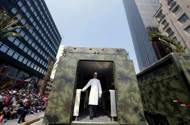 A Mexican Army cook stands inside a truck march during the celebration of the 202nd anniversary of the country's independence at Juarez Avenue in Mexico City on September 16, 2012.   AFP PHOTO/Alfredo Estrella        (Photo credit should read ALFREDO ESTRELLA/AFP/GettyImages) Photo: ALFREDO ESTRELLA, Getty Images / 2012 AFP