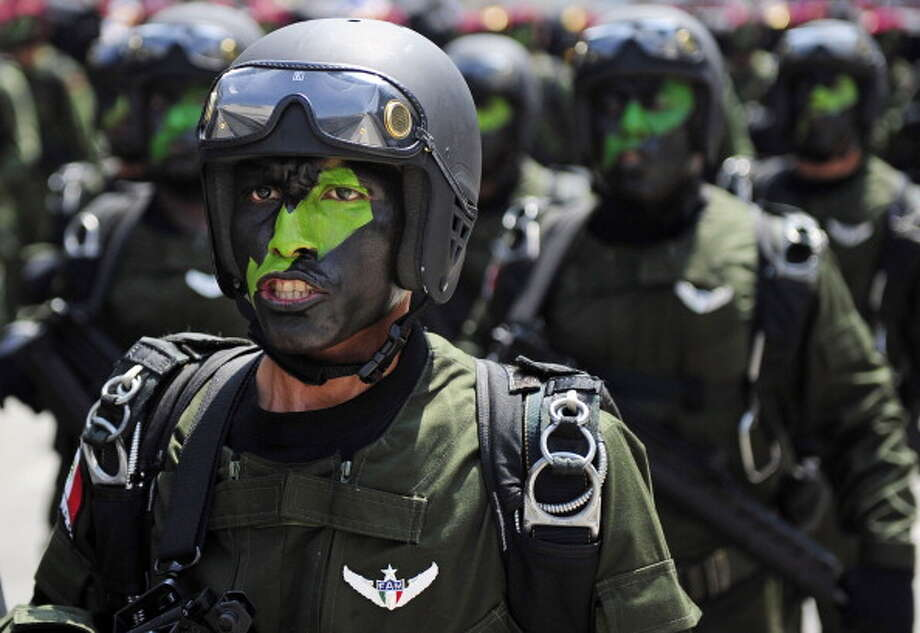 Mexican Army paratroopers march during the celebration of the 202nd anniversary of the country's independence at Juarez Avenue in Mexico City on September 16, 2012.   AFP PHOTO/Alfredo Estrella        (Photo credit should read ALFREDO ESTRELLA/AFP/GettyImages) Photo: Getty Images