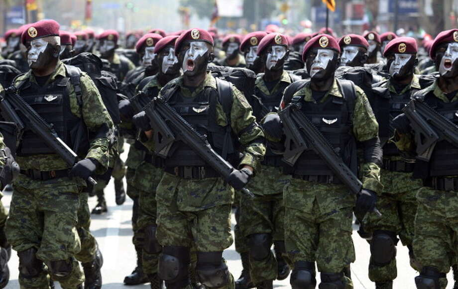 A Mexican Army Paratroopers squad march during the celebration of the 202nd anniversary of the country's independence at Juarez Avenue in Mexico City on September 16, 2012.   AFP PHOTO/Alfredo Estrella        (Photo credit should read ALFREDO ESTRELLA/AFP/GettyImages) Photo: Getty Images