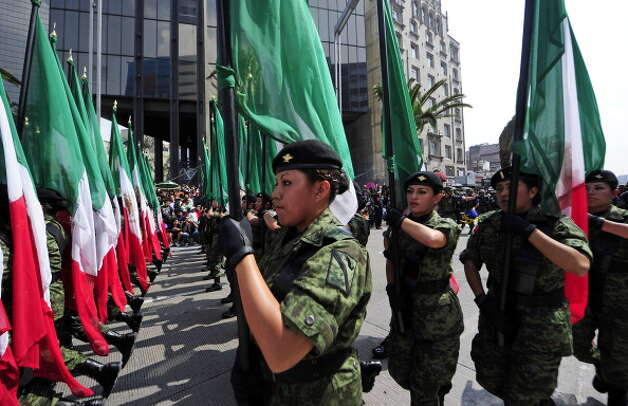 Mexican female soldiers march during the celebration of the 202nd anniversary of the country's independence at Juarez Avenue in Mexico City on September 16, 2012.   AFP PHOTO/Alfredo Estrella        (Photo credit should read ALFREDO ESTRELLA/AFP/GettyImages) Photo: Getty Images