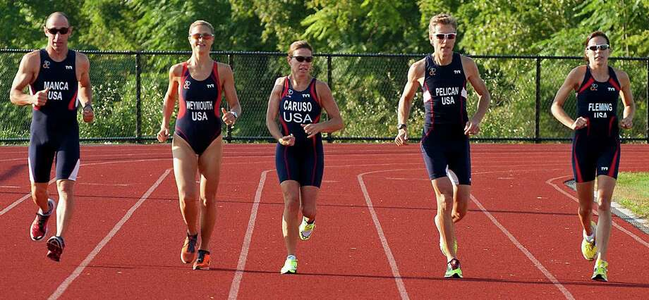 Shown here are five Bethel Cycle Club members, from the left, Anthony Manca, Lauren Weymouth, Robin Caruso, Greg Pelican and Susan Fleming, who will compete in the World Duathlon in France later this week. Photo: Contributed Photo / The News-Times Contributed