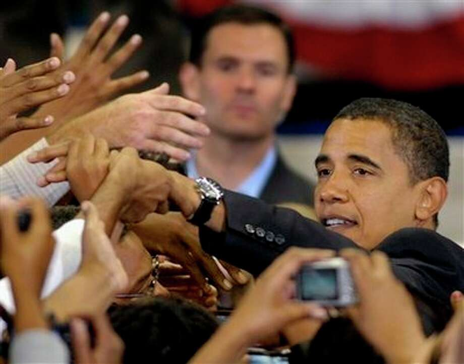 Democratic presidential candidate Sen. Barack Obama, D-Ill., shakes hands during his rally in Fayetteville, N.C., Sunday, Oct. 19, 2008. Photo: Sara D. Davis, AP / FR73479 AP