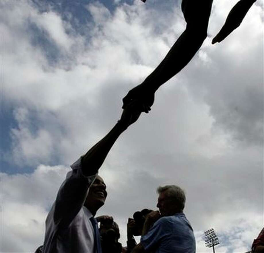 Democratic presidential candidate Sen. Barack Obama, D-Ill. shakes hands during a rally at Legends Field in Tampa, Fla., Monday, Oct. 20, 2008. Photo: Alex Brandon, AP / AP