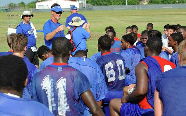 The West Brook High School football team opened practice on Monday, August 13, 2012.   Head coach Kevin Flanigan, left of center, talked to the team before dismissing them for the morning.  Dave Ryan/The Enterprise Photo: Paul Chinn