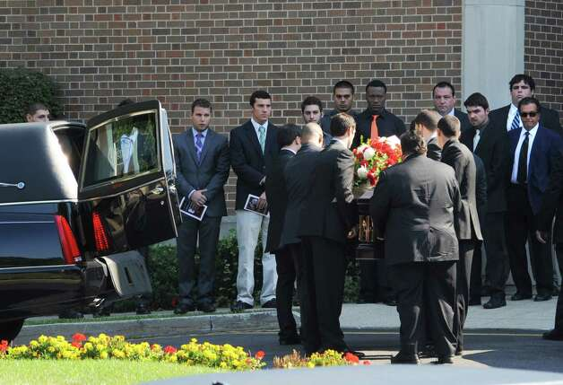 Friends lined up as the pallbearers enter the Church of the Holy Spirit in Stamford, Conn. for the funeral for Marcus Dixon McInerney on Monday Sept. 17, 2012. Photo: Cathy Zuraw / Stamford Advocate