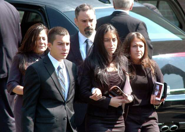 Mourners console each other at the conclusion of the funeral service for Marcus Dixon McInerney at Church of the Holy Spirit in Stamford, Conn. on Monday Sept. 17, 2012. Photo: Cathy Zuraw / Stamford Advocate