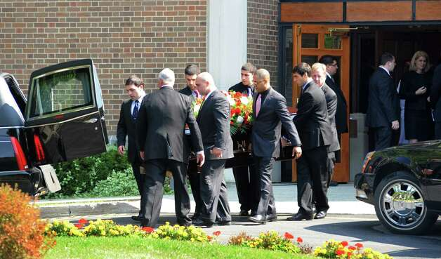 Pallbearers exit the funeral service for Marcus Dixon McInerney at Church of the Holy Spirit in Stamford, Conn. on Monday Sept. 17, 2012. Photo: Cathy Zuraw / Stamford Advocate