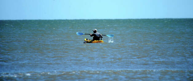 A man kyaks in the Gulf of Mexico near Crystal Beach on the Bolivar Peninsula, Saturday,  April 21, 2012. Tammy McKinley/The Enterprise Photo: TAMMY MCKINLEY