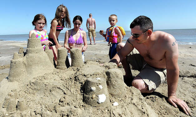 The Gibson family of Conroe build sand castles on the beach on the Bolivar Peninsula, Saturday,  April 21, 2012. Tammy McKinley/The Enterprise Photo: TAMMY MCKINLEY