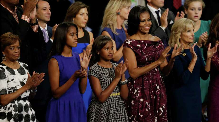 From left, Michelle Obama's mother Marian, Malia and Sasha Obama, their mother Michelle and Dr. Jill Biden, wife of Vice President Biden, listen to President Barack Obama at the Democratic National Convention in Charlotte, N.C., on Thursday, Sept. 6, 2012. (AP Photo/Lynne Sladky) Photo: Lynne Sladky, Associated Press / AP