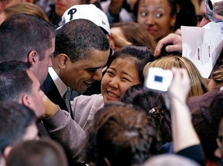 Democratic presidential hopeful Sen. Barack Obama, D-Ill., second from left, is greeted by a supporter during a rally for Obama in East Rutherford, N.J., Monday, Feb. 4, 2008, in the final campaign push before Super Tuesday. Photo: Mike Derer, AP / AP