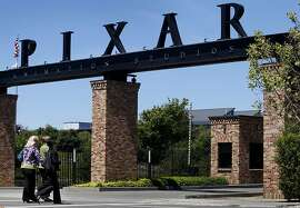 Pedestrians walk towards Pixar Animation Studios on Park Avenue in Emeryville, Calif., on Thursday, May 6, 2010.