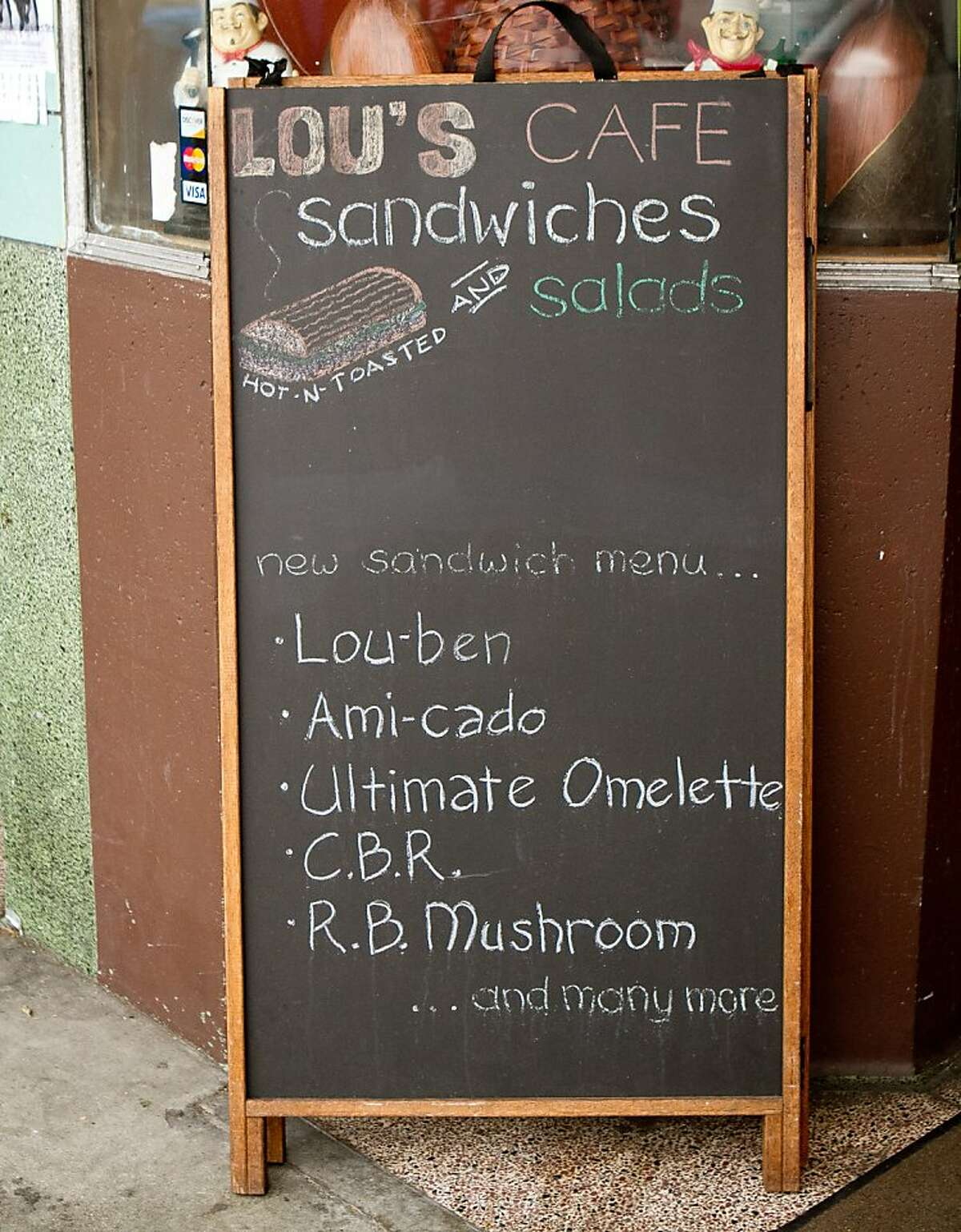 The sandwich board outside of Lou's Cafe in San Francisco is seen on Friday, September 14th, 2012.