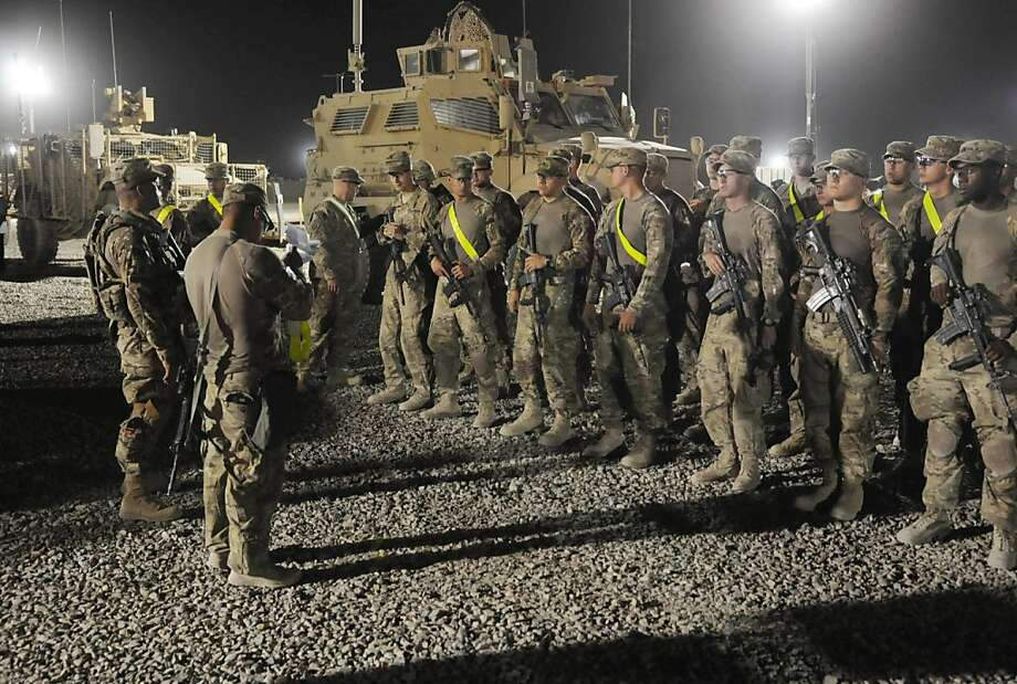 Soldiers from the 82nd Airborne Division prepare to turn in their equipment at Kandahar Air Field last month as part of the drawdown of U.S. troops. Photo: Staff Sgt. Michael Behlin, Associated Press