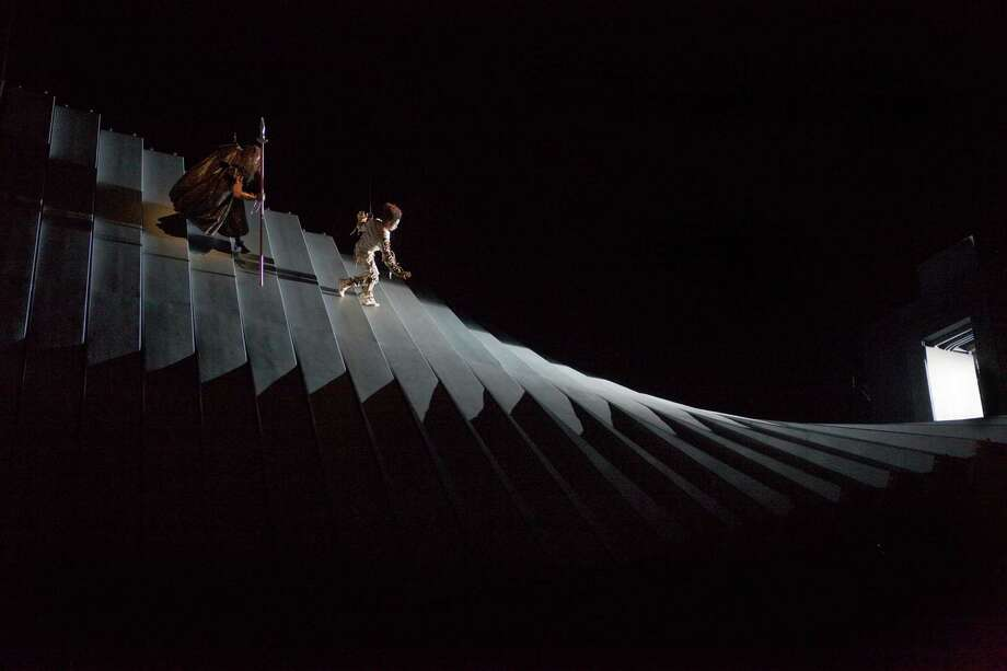"In this Sept. 11, 2010 photo provided by the Metropolitan Opera, a scene from Wagner's ""Das Rheingold"" is rehearsed at the Metropolitan Opera in New York. The set, created by director Robert Lepage and unlike any ever seen on an opera stage, will be put on public view for the first time Monday night Sept. 27, when the company opens its season with ìDas Rheingold,"" first of the four operas that make up the""Ring"" cycle. (AP Photo/Metropolitan Opera, Ken Howard) Photo: Ken Howard / Metropolitan Opera"