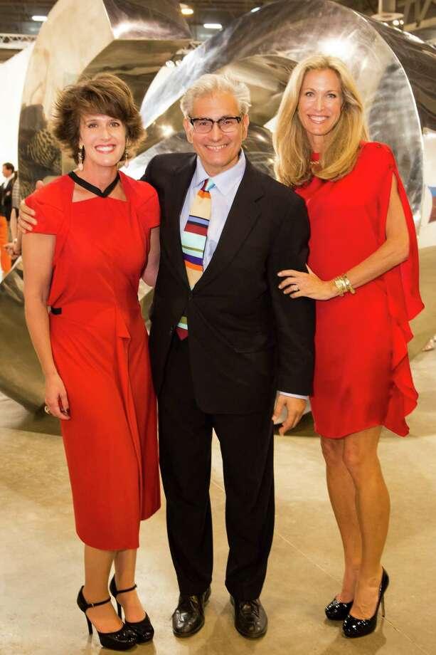 Melissa Grobmyer, left, fair CEO Rick Friedman and  Janet Hobby Photo: Bruce Bennett, Staff / Houston Chronicle