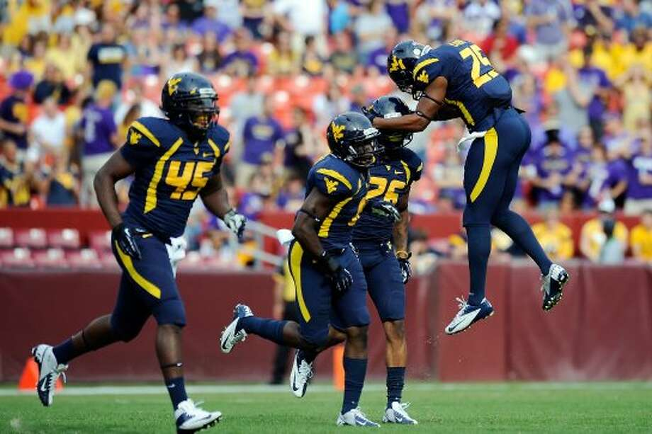 1. West Virginia (2-0, last week No. 1) — Geno Smith has as many touchdown passes as incompletions so far this season. (Patrick McDermott / Getty Images)