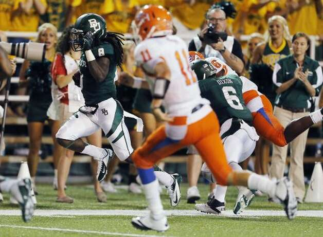 Baylor safety K.J. Morton returns an interception, one of four second-turnovers the Bears forced in what turned out to be a runaway win over Sam Houston State.