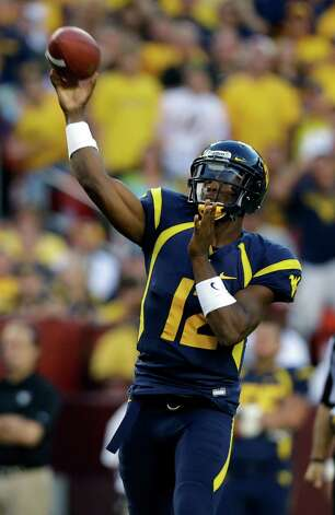 West Virginia quarterback Geno Smith throws a touchdown pass during the second half of an NCAA college football game against James Madison Saturday, Sept. 15, 2012, in Landover, Md. West Virginia won 42-12. (AP Photo/Alex Brandon) Photo: Alex Brandon, Associated Press / AP