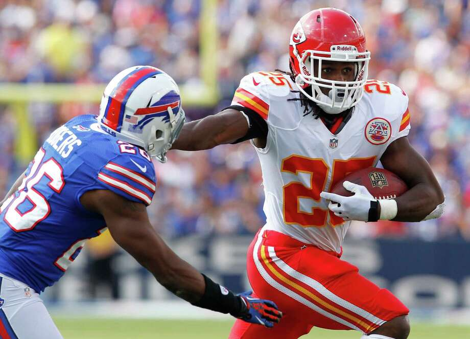 Kansas City Chiefs' Jamaal Charles (25) runs under pressure from Buffalo Bills' Justin Rogers (26) during the second half of an NFL football game in Orchard Park, N.Y., Sunday, Sept. 16, 2012. (AP Photo/Bill Wippert) Photo: Bill Wippert, FRE / AP2012