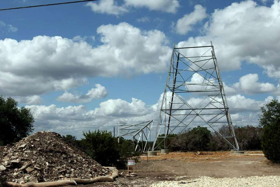 Power towers near Junction is being assembled as crews have cleared the right of way for the power lines in Kerr and Kimble counties. Critics of the project, who want work stopped, say it is unsightly. The work approved by the Public Utility Commission is being done by the Lower Colorado River Authority's Transmission Services Corporation. Photo: Helen L. Montoya, SAN ANTONIO EXPRESS-NEWS / SAN ANTONIO EXPRESS-NEWS