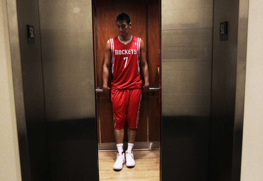 Rockets guard Jeremy Lin gets into an elevator on his way to a photo shoot upon his arrival at the T