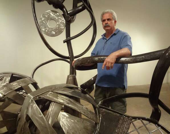 Dallas sculptor George Tobolowsky scours junkyards for scrap to make his art, such as this monumental metal bra made to draw attention to breast cancer research. Photo: Photo By Steve Bennett