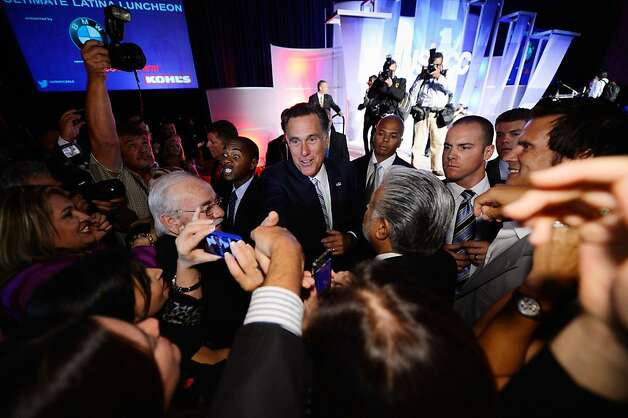 GOP presidential candidate Mitt Romney acknowledges supporters at the Hispanic Chamber of Commerce convention in L.A. Photo: Kevork Djansezian, Getty Images / SF