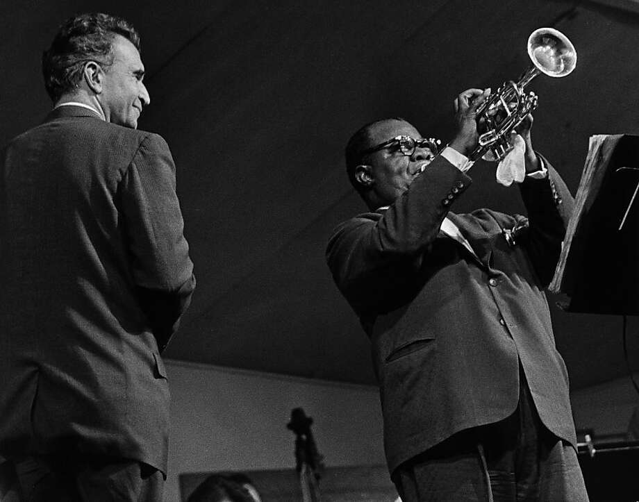 Noted pianist and composer Dave Brubeck, a Concord native who studied under Darius Milhaud at Mills College, watches as Louis Armstrong plays the trumpet at the 1962 Monterey Jazz Festival. Photo: Monterey County Herald, MJF Archives