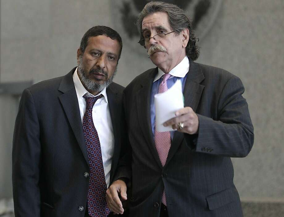 Defense attorney Thomas Durkin (right) consults with Adel Daoud's father, Ahmed Daoud, at a news conference after the younger Daoud's appearance at the federal courthouse in Chicago. Photo: M. Spencer Green, Associated Press