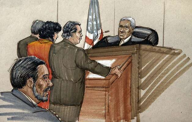 In this courtroom sketch, 18-year-old Adel Daoud, stands before Federal Court Judge Arlander Keys, with attorneys Joss Heiman, left, and Thomas Durikn, as Daoud's father Ahmed Daoud, rear, looks on, Monday, Sept. 17, 2012, in Chicago. Daud made an initial appearance in court on charges he sought to detonate what he believed to be a car bomb outside a Chicago bar last Friday night. A court affidavit says Daoud was active in jihadist Internet forums. (AP Photo/Tom Gianni) Photo: Tom Gianni, Associated Press