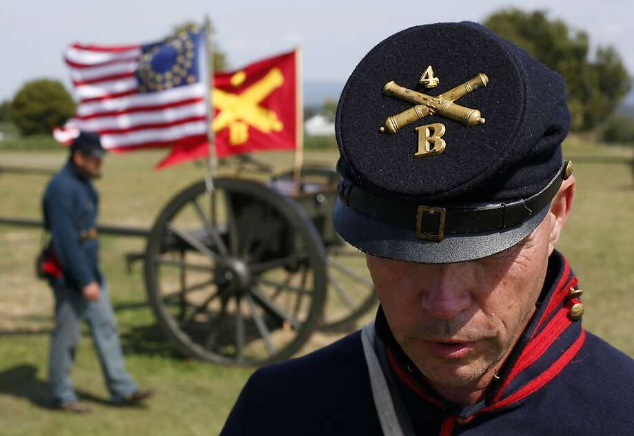 Jim Rosebrock, a volunteer portraying a member of the Union Army's 4th U.S. Artillery, prepares for a cannon firing demonstration at Antietam National Battlefield in Sharpsburg, Md., Monday, Sept. 17, 2012. A series of demonstrations and speeches took place at the battlefield to commemorate the 150th anniversary of the Civil War's Battle of Antietam. (AP Photo/Patrick Semansky) Photo: Patrick Semansky, Associated Press