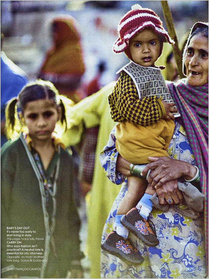 In 2008 India Vogue used poor people as props, dressing them in uber-expensive clothing. In this photo a child wears a $100 Fendi bib.
