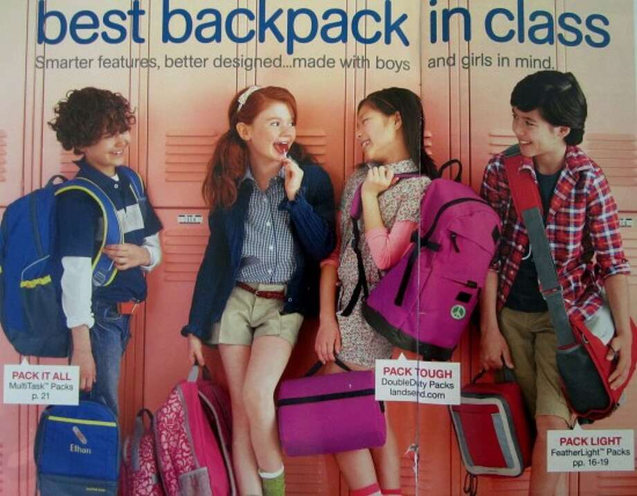 Land's End is perfectly wholesome? Maybe not. One of the flirty girl's in this 2011 catalog photo is wearing hiked up shorts and licking a lollipop.