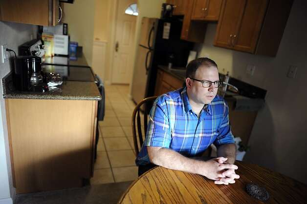 "Greg Annis poses for a portrait at his Pleasanton condo that he bought for $390,000 in 2007 and is now worth about $200,000.  He wants to sell it in a short sale, and is concerned about closing the sale before year end when a tax break for ""forgiven debt"" is supposed to expire.  Pleasanton, CA Thursday September 13th, 2012 Photo: Michael Short, Special To The Chronicle / SF"