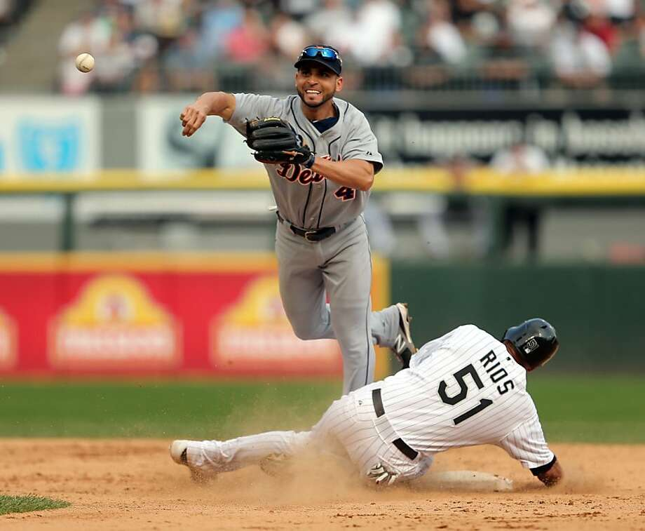 Alex Rios slid hard into Infante, the second baseman, and forced an errant throw, right, past first baseman Prince Fielder as two runs scored. Photo: Nuccio DiNuzzo, McClatchy-Tribune News Service