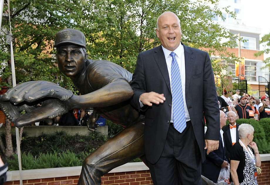 Former Baltimore Orioles legend and member of the Major League Baseball hall of fame, Cal Ripken, Jr., poses with his statue at a ceremony to unveil his statue before a baseball game against the New York Yankees, Thursday, Sept. 6, 2012, in Baltimore. (AP Photo/Nick Wass) Photo: Nick Wass, Associated Press